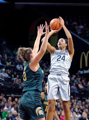 Connecticut's Nepheesa Collier shoots over Michigan State's Jenna Allen in the first half during the Phil Knight Invitational tournament in Eugene, Ore., Saturday, Nov. 25, 2017.
