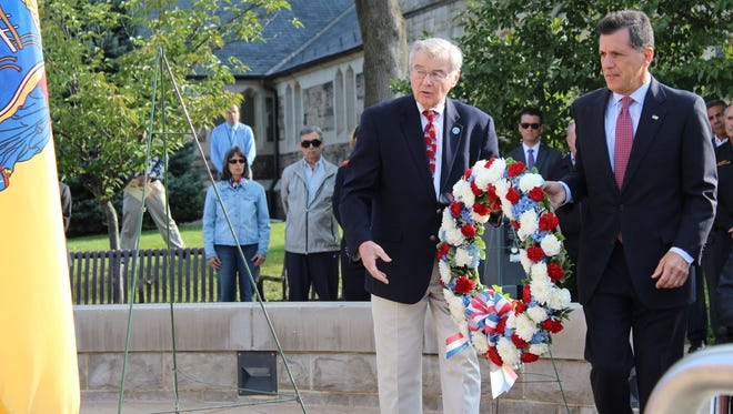Somerset County Freeholders Peter Palmer, left, and Mark Caliguire place a wreath at the county 9/11 memorial on Monday, Sept. 11, 2017