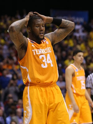Tennessee's Jeronne Maymon reacts to his team losing a chance to take the lead on a charging call in the final seconds against Michigan. Tennessee faced off with Michigan in the first  game of the NCAA Regional at Lucas Oil Stadium in Indianapolis Friday, March 28, 2014.