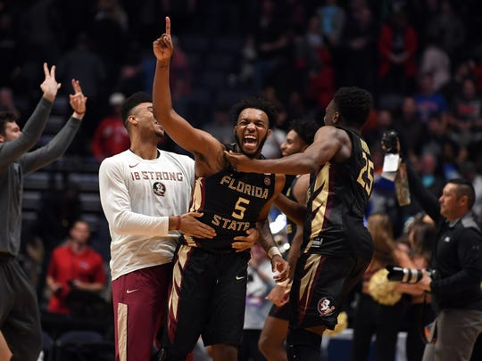 Mar 18, 2018; Nashville, TN, USA; Florida State Seminoles guard PJ Savoy (5) celebrates after defeating the Xavier Musketeers in the second round of the 2018 NCAA Tournament at Bridgestone Arena. Mandatory Credit: Christopher Hanewinckel-USA TODAY Sports