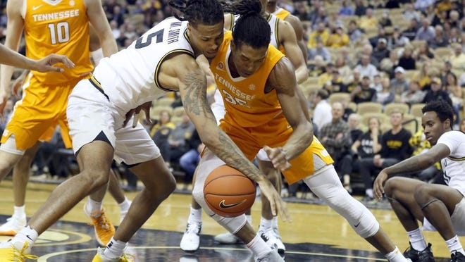 Missouri's Mitchell Smith (5) tries to grab a loose ball while Tennessee's Yves Pons (35) attempts to do the same during a Southeastern Conference game in January at Mizzou Arena.