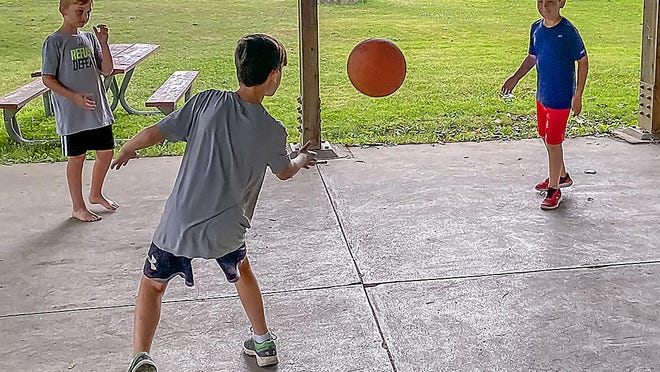 Youth played four square Wednesday morning in Denison Park.