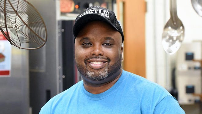 Andre Clark of the Child Nutrition staff at Contentnea-Savannah K-8 School is the School Nutrition Association's 2020 Employee of the Year for North Carolina.