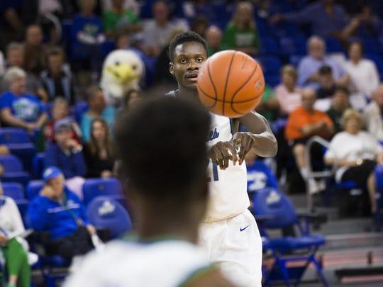 Florida Gulf Coast University senior, Demetris Morant, passes to his teammate during the game against Florida International University on Sunday, December 11, 2016 at Alico Arena in Estero, Fla.