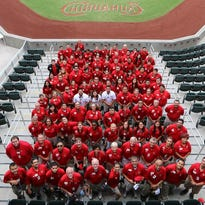 El Paso Chihuahuas baseball team employees pose for a group photo in 2014.