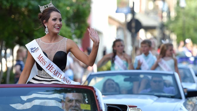 Miss Heartland Abigail Walters waves to the crowd on Monday, June 20, 2016, while riding in the Miss Mississippi Pageant Parade down Washington Street in downtown Vicksburg, Miss.