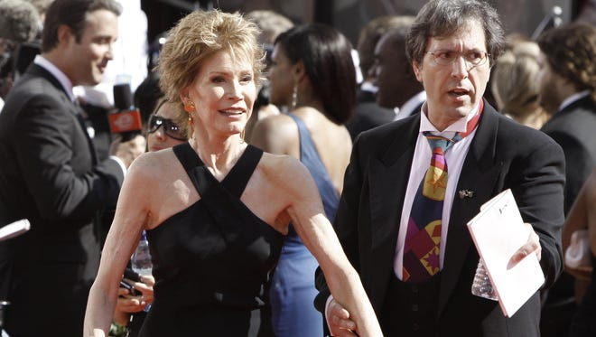 Mary Tyler Moore, left, arrives at the 60th Primetime Emmy Awards in Los Angeles in this file photo from Sept. 21, 2008.