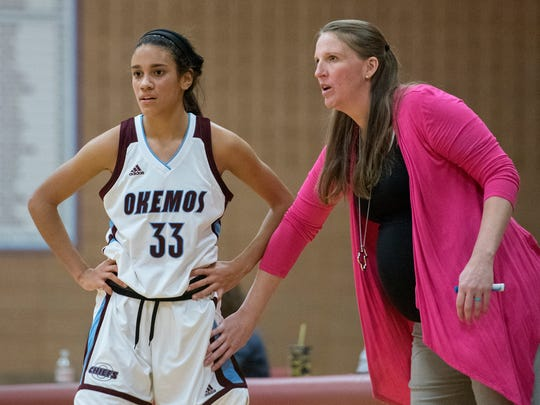Okemos head coach Katie Seidl, right, talks with Laya