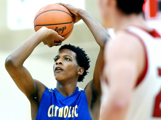 Catholic Central High School senior forward and Michigan State University commit Marcus Bingham Jr. shoots a free throw during the second half of Central's game against Allendale on Tuesday, Jan. 16, 2018, at Allendale High School.