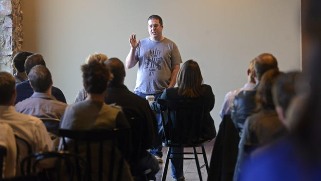 Chris Hamze talks to audience members about his company, TeeLaunch Wednesday at a One Millions Cups Sioux Falls meeting at Prairie Berry East Bank, Dec 10, 2014.