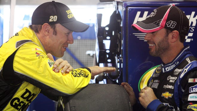 Matt Kenseth (left) and Jimmie Johnson share a light moment in the Martinsville Speedway garage.