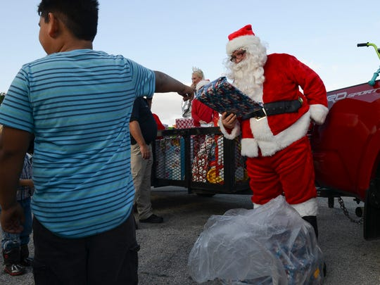 Larry Sinclair, AKA the Broadmoor Santa and his helpers deliver presents to the Broadmoor Acres section of Cocoa.