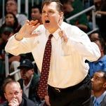 Eastern Kentucky coach Jeff Neubauer talks to his players during the second half of an NCAA college basketball game against Miami in Coral Gables, Fla., Friday, Dec. 19, 2014. Eastern Kentucky defeated Miami 72-44. (AP Photo/Joel Auerbach)