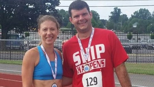 Waynesboro's Willow Weir and Andy Sandrik pose for a photo after the Tim & Susan Cook Memorial Race on July 9. Weir scored a narrow victory and currently enjoys a 7-0 lead in the head-to-head series with Sandrik.