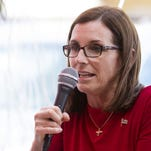 Prison company detaining immigrants has helped McSally, others in GOP