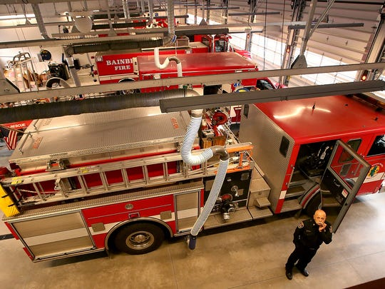Bainbridge Island Fire Chief Hank Teran glances at the storage loft as he walks through the apparatus bay of the new station 21 on Wednesday.