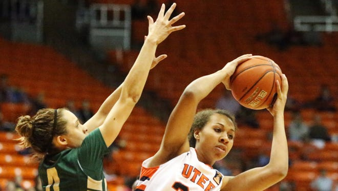 UTEP's Daeshianna McCants, 33, grabs a rebound over UAB's Bianca Dufelmeier Sunday night in the Don Haskins Center.