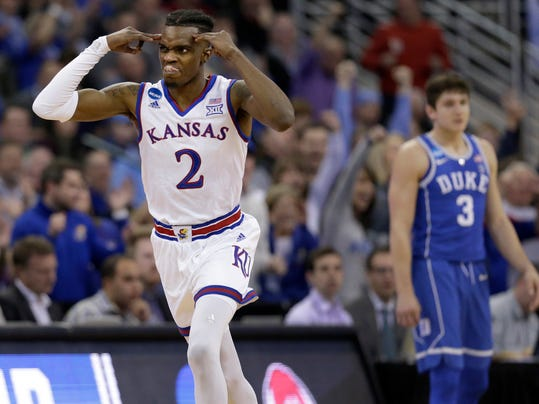 Kansas' Lagerald Vick, left, celebrates after making a 3-point basket as Duke's Grayson Allen is seen in the background during the second half of a regional final game against Duke in the NCAA men's college basketball tournament Sunday, March 25, 2018, in Omaha, Neb. (AP Photo/Nati Harnik)