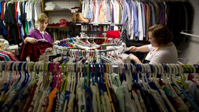 Sarah Gough (left) and Salena Courtney organize clothing at Borrowed Hearts, a facility at 121 Walnut Street in Evansville started by Gough as a 24-hour resource for foster parents to clothe and supply hygiene products their fosters.