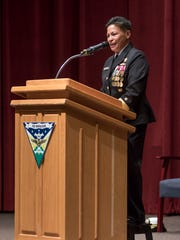Rear Adm. Bette Bolivar speaks during the change of command ceremony at Whiting Field Naval Air Station in Milton on Monday, December 18, 2017.