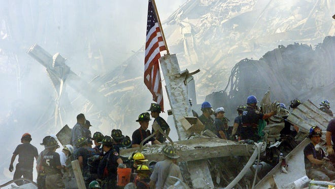 File photo taken on Sepember 13, 2001 shows an American flag amid  the rubble of the collapsed World Trade Center towers in New York City as emergency responders searched for survivors of the terrorist attack.