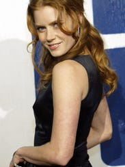 Amy Adams poses for photographers during arrivals at