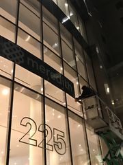 Workers install Meredith's banner on the former Time