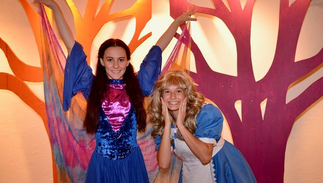"""The Caterpillar (Alex Lewis) and Alice (Bailey Swint) talk a bit of nonsense in """"Disney's Alice in Wonderland Jr.,"""" which will end its run this weekend at the Wichita Theatre."""