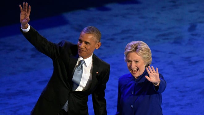 President Obama and Hillary Clinton on stage during the 2016 Democratic National Convention at Wells Fargo Center.