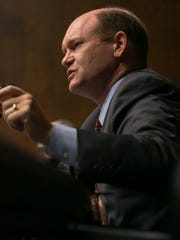 Sen. Chris Coons, D-Del., joined Sen. John McCain,