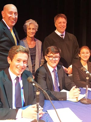 Dr. Mark Malham, standing, from left, coordinator of Social Studies & Special Projects for Martin County School District; Kate Boland, Center for Constitutional Values executive director, and Judge Alan Forst; with, sitting, contestant Nick Ciampi, winner Sam Crombie and contestant Isla Lader at the Martin County High School competition.