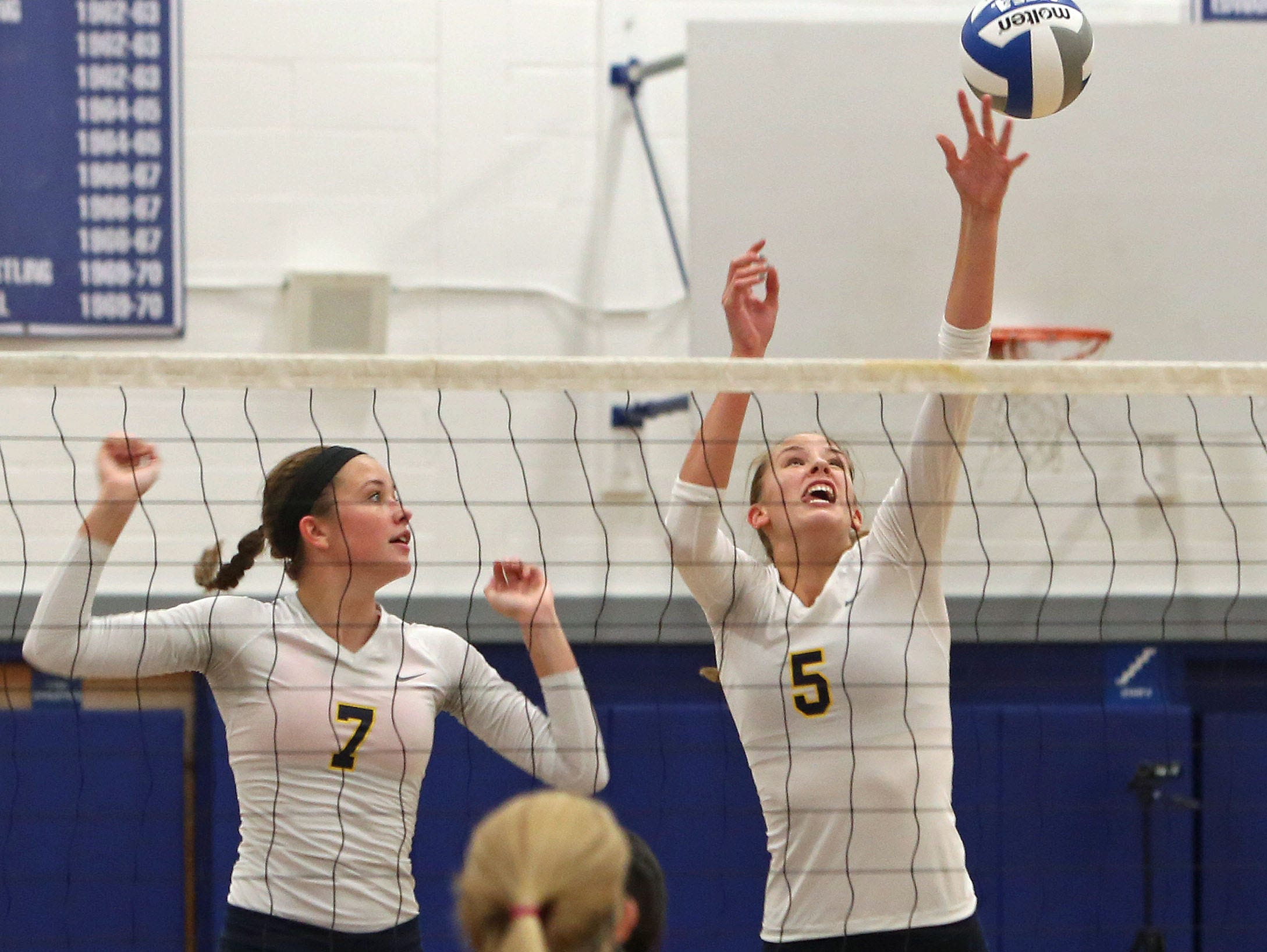 From right, Walter Panas' Yvette Burcescu (5) returns a shot against Hen Hud during volleyball action at Hendrick Hudson High School in Montrose Oct. 8, 2015. Panas swept the host 3-0.