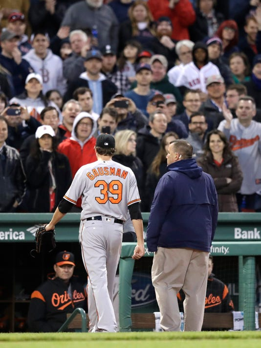 Baltimore Orioles starting pitcher Kevin Gausman heads to the dugout after being ejected for hitting Boston Red Sox Xander Bogaerts with a pitch during the second inning of a baseball game at Fenway Park in Boston, Wednesday, May 3, 2017. (AP Photo/Charles Krupa)
