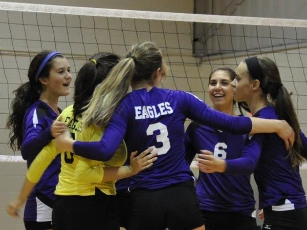 PCA players show their enthusiastic teamwork during Tuesday's match.