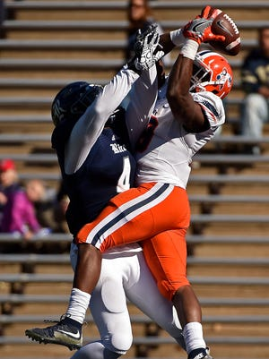 UTEP running back Aaron Jones, right, catches a 42-yard touchdown over Rice linebacker Alex Lyons during the second half of an NCAA college football game, Saturday, Nov. 19, 2016, in Houston. Rice won 44-24.