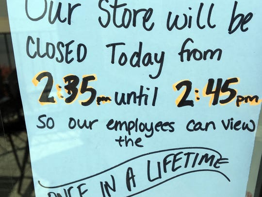 Sign hangs in a window of a store in Waynesboro — closing
