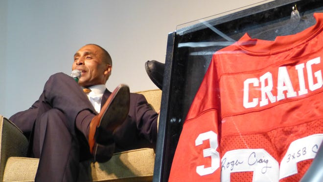 San Francisco 49er great Roger Craig speaks at the 23rd annual Shasta College Celebrity Dinner Auction on Friday night at Win-River Casino.