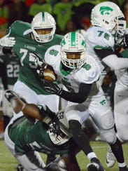 Novi's Emanuel Jackson (5), getting a seal blcok from
