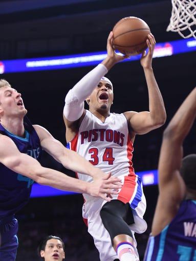 Detroit Pistons' Tobias Harris scores over the Charlotte