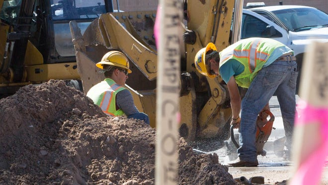 Work continues on the Church and Water Street conversion on Monday Oct. 23, 2017. Contractors are seen at work on South Church Street.