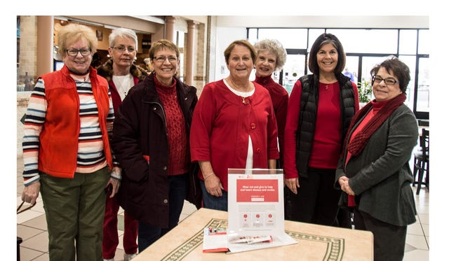 "Members of the Millville Woman's Club joined the American Heart Association for its ""Wear Red"" day on Feb. 2, which promoted the association's campaign to fight heart attacks and stroke. Members (from left) Jane Christy, event chairman, Pat Deininger, Barbara Westog, Louise Jones, Nancy Hammond, Claudia Rempfer, and Pam McNamee, president, walked as a group at Cumberland Mall. Member Carol Smith also participated but is not pictured as she was the ""club photographer"" for the event."
