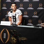 Oregon quarterback Marcus Mariota talks to reporters at Media Day on January 10, 2015 ahead of the College Football Playoff.