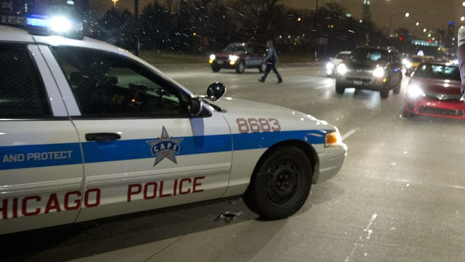 A Chicago police car is seen in this photo taken Friday night in Chicago.