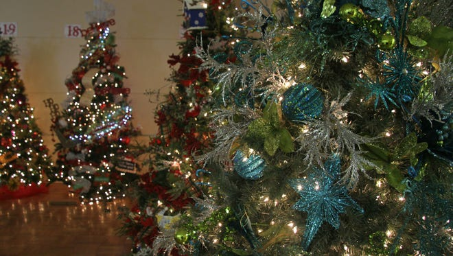 Assistance League of Carlsbad will hosts its annual tree auction on Thursday.