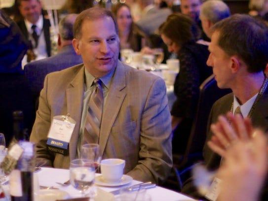 Dan Eck, the president of Lakeland College, has a conversation