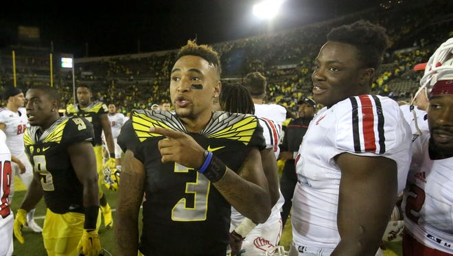Oregon Ducks quarterback Vernon Adams (3) talks former teammates after the game with Eastern Washington on Sept. 5, 2015, in Eugene, Ore.