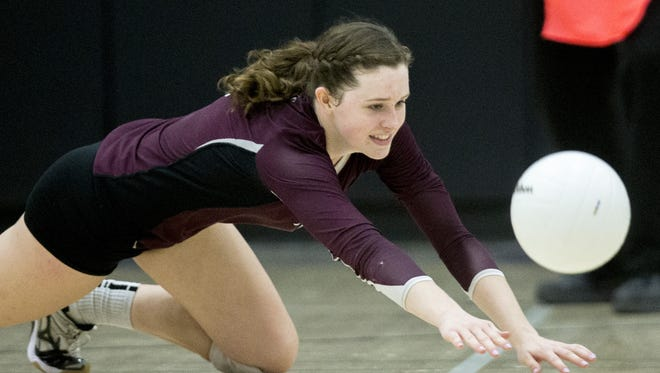 Hamilton High School's Hailey Babcock dives for a ball while playing Xavier in a Division I girls volleyball semifinal in 2014.
