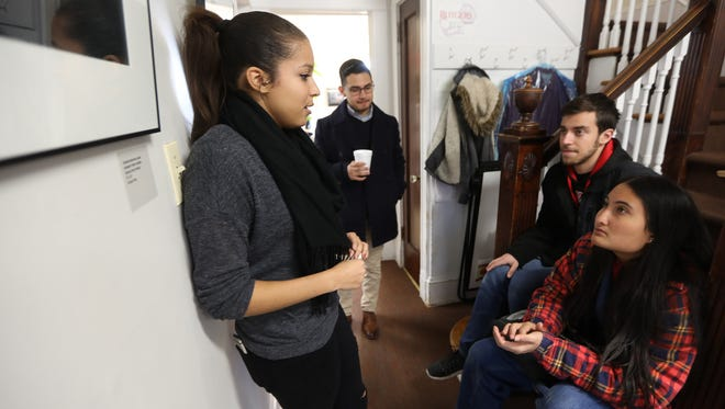 Carimer Andujar (left), 21, an undocumented Rutgers student from Passaic,  at the Rutgers Center for Latino Arts and Culture with Monica Torres, Sergio Abreu and Jose Serrano, all 20 years old.
