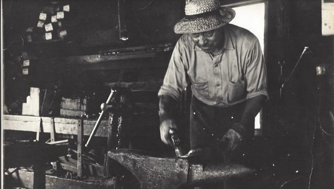 Samuel Outlaw is depicted at work in his blacksmith shop in Onancock, Virginia in this circa 1969 photograph, which is in the collection of the Eastern Shore of Virginia Historical Society.