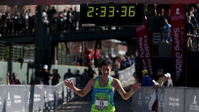 December 2, 2017 - Top male finisher Chris Raulli, 29, of Manlius, NY, had a race time of 2:33:36 in the full marathon during the 16th Annual St. Jude Memphis Marathon Weekend in AutoZone Park on Saturday. The event drew more than 25,000 people from 49 states and 19 countries. The occasion is the largest single-day fundraising event for St. Jude Children's Research Hospital.